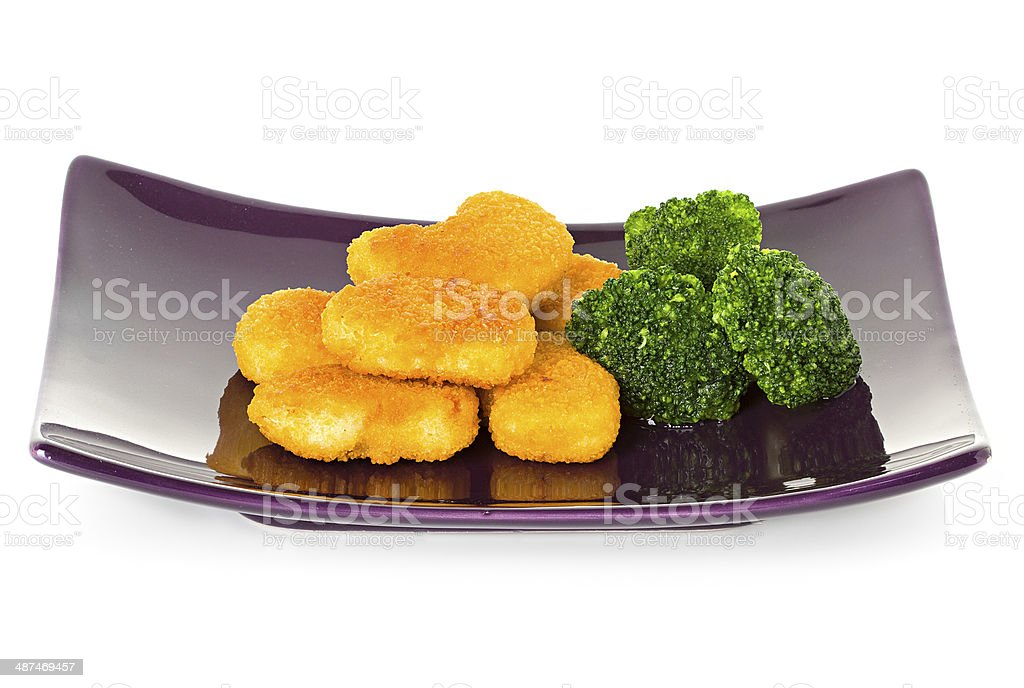 chicken nuggets and brussels sprouts stock photo