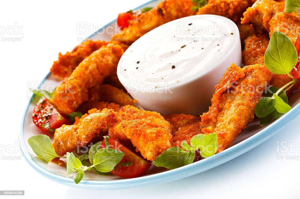 Chicken nuggets and vegetables on white background stock photo