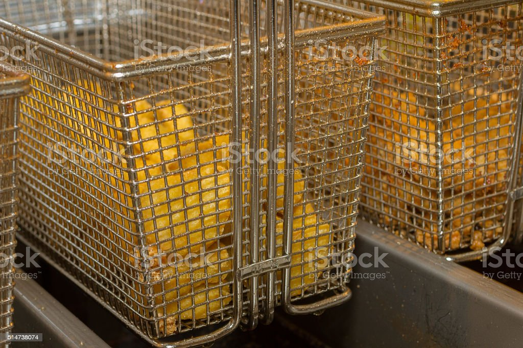 Chicken nuggets in a fryer stock photo