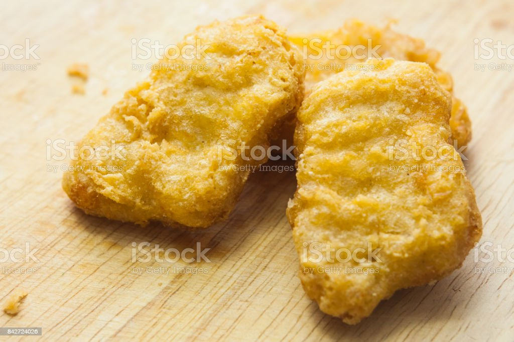 Chicken nuggets isolated on white background stock photo