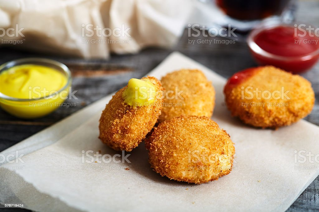 Chicken nuggets on white plate stock photo