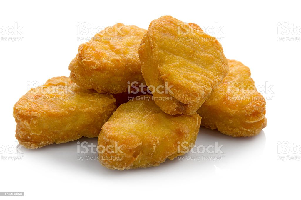 Chicken nuggets piled together isolated on white background stock photo