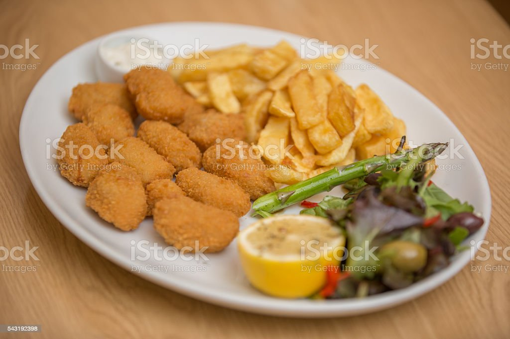 Chicken Nuggets with Chips and Salad stock photo