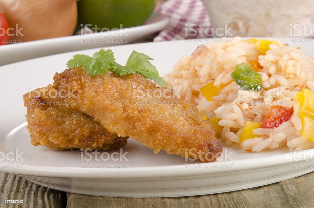 chicken nuggets with rice salad stock photo
