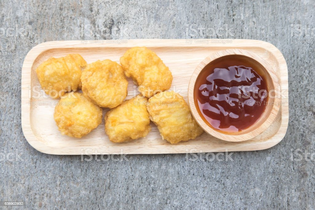 Chicken nuggets with tomato sauce stock photo