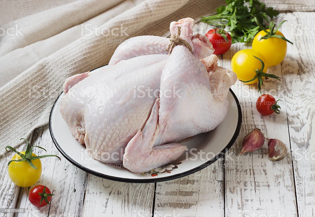 Chicken on a white wooden background stock photo