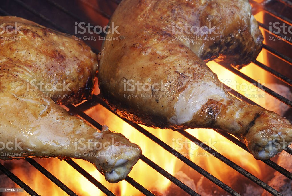 Chicken on the Barbecue.  Flames from Grill. royalty-free stock photo