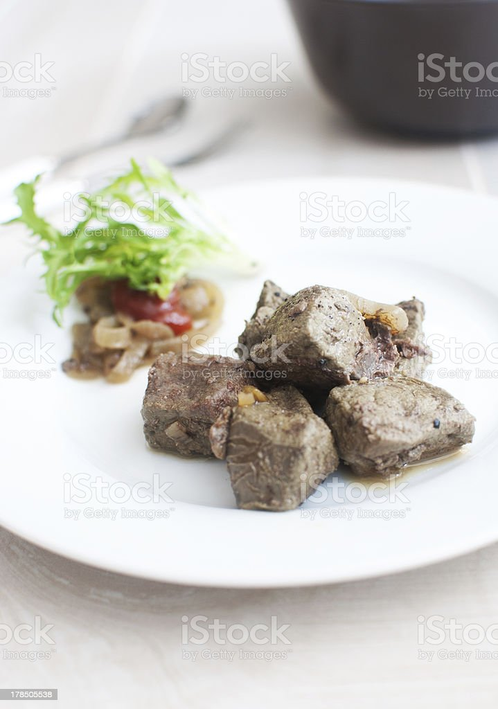 Chicken or beef liver pieces sauteed stock photo