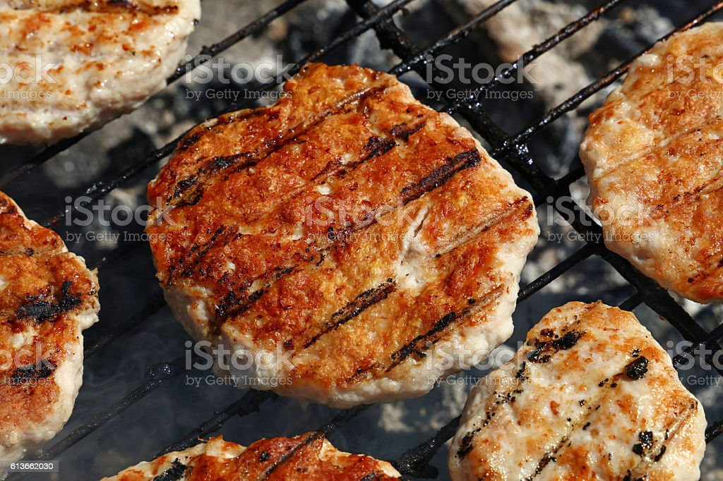 Chicken or turkey burgers for hamburger on grill stock photo