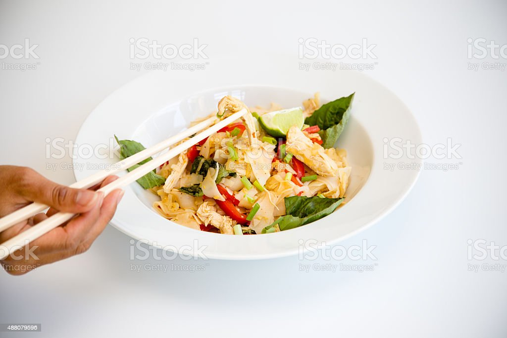 Chicken Pad Kee Mao with Bell Pepper and Thai Basil stock photo