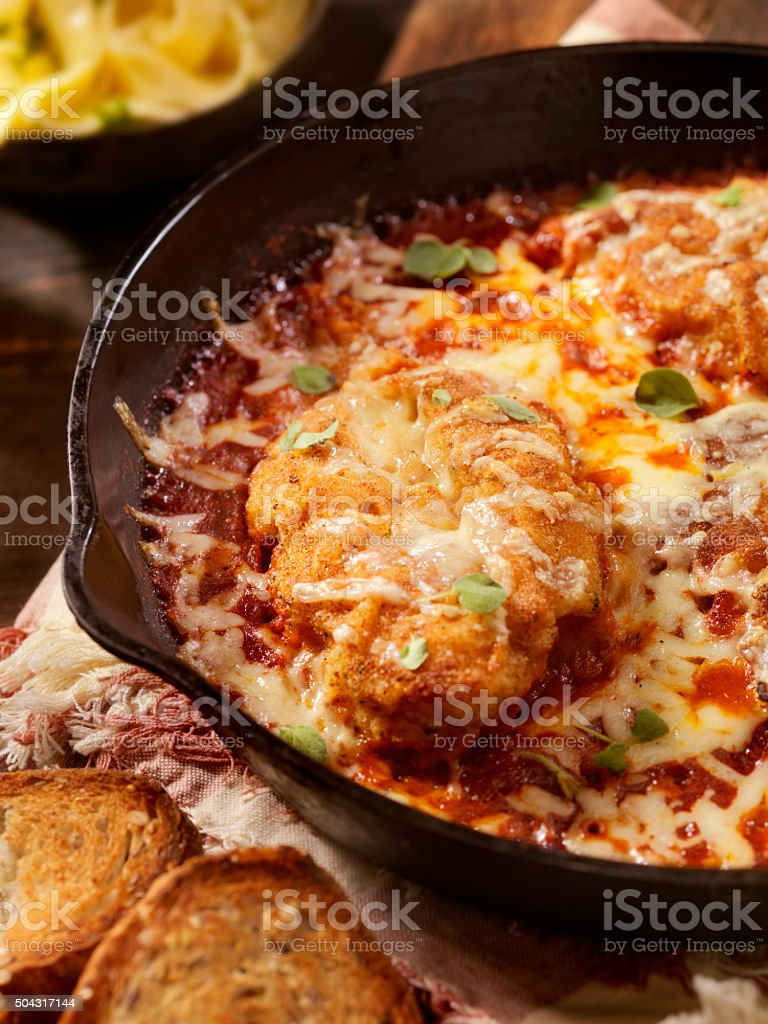 Chicken Parmesan Baked in Tomato Sauce with Mozzarella Cheese stock photo
