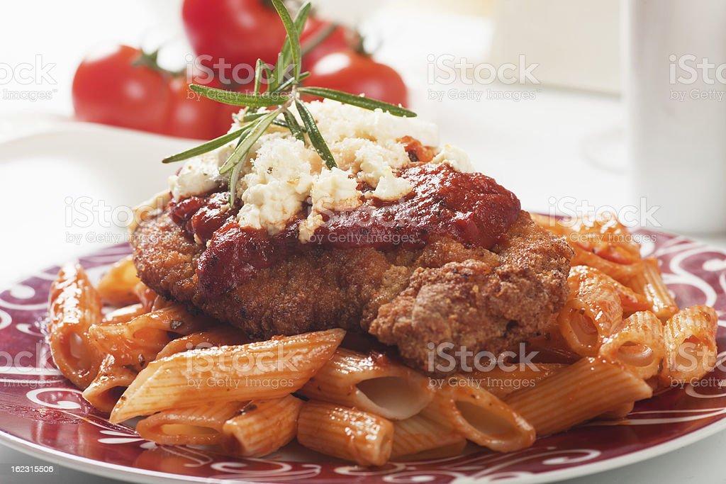 Chicken parmesan with macaroni pasta stock photo