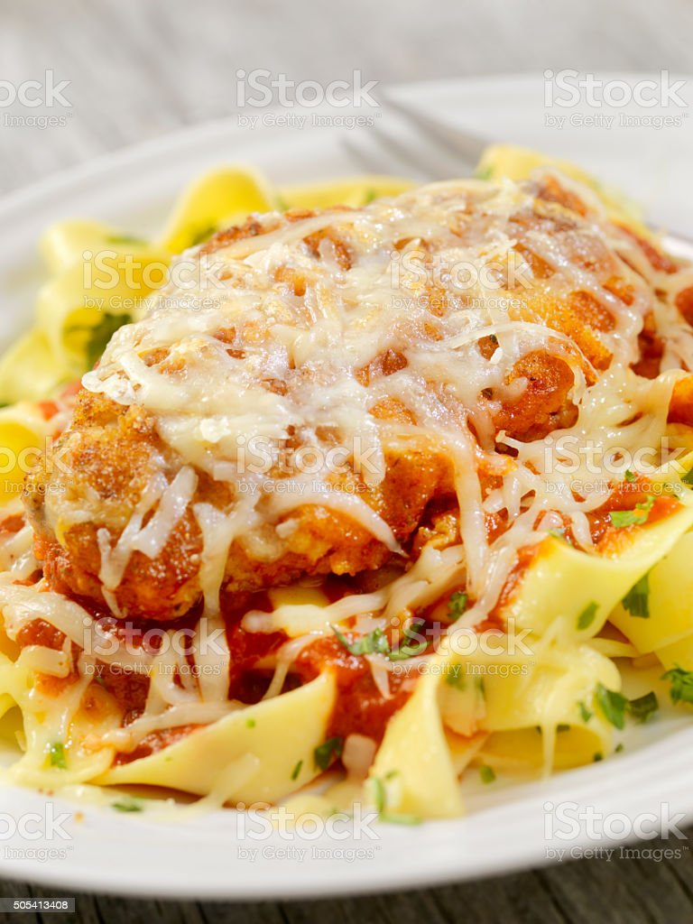 Chicken Parmesan with Pasta and Tomato Sauce stock photo