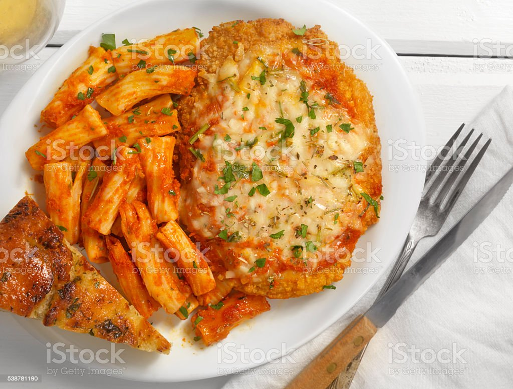 Chicken Parmesan with Rigatoni and Tomato Sauce stock photo