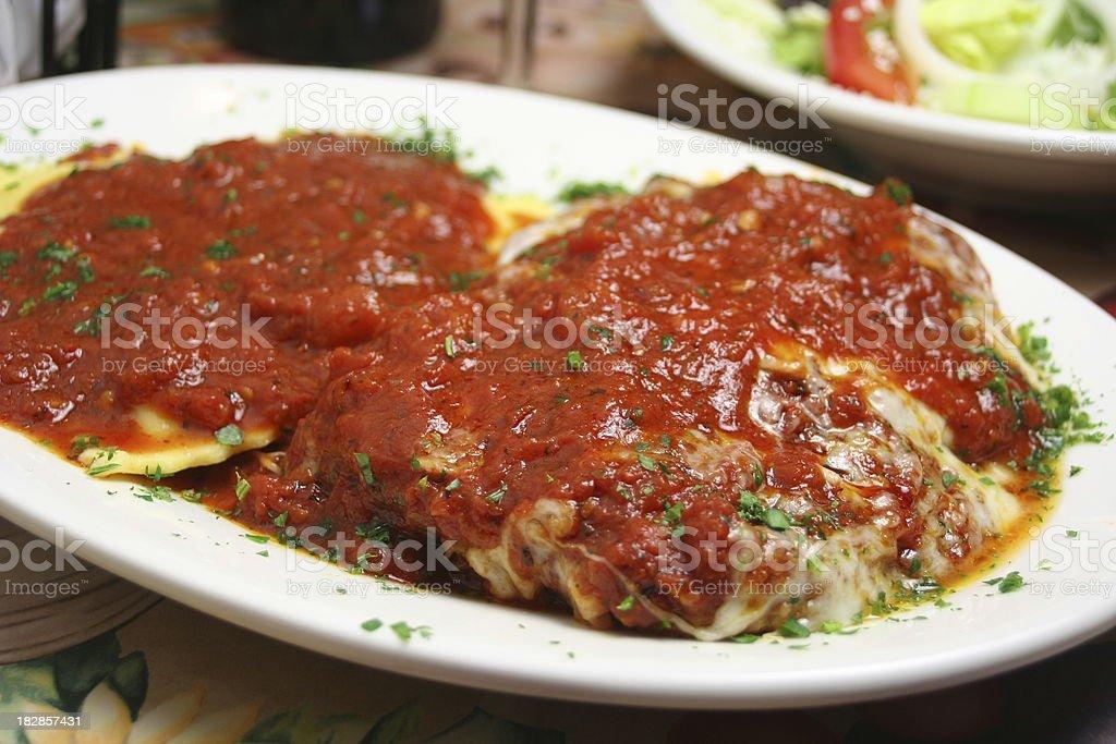 Chicken Parmgiano with Ravioli stock photo