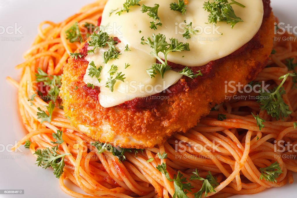 Chicken parmigiana and spaghetti close-up on a plate. horizontal stock photo