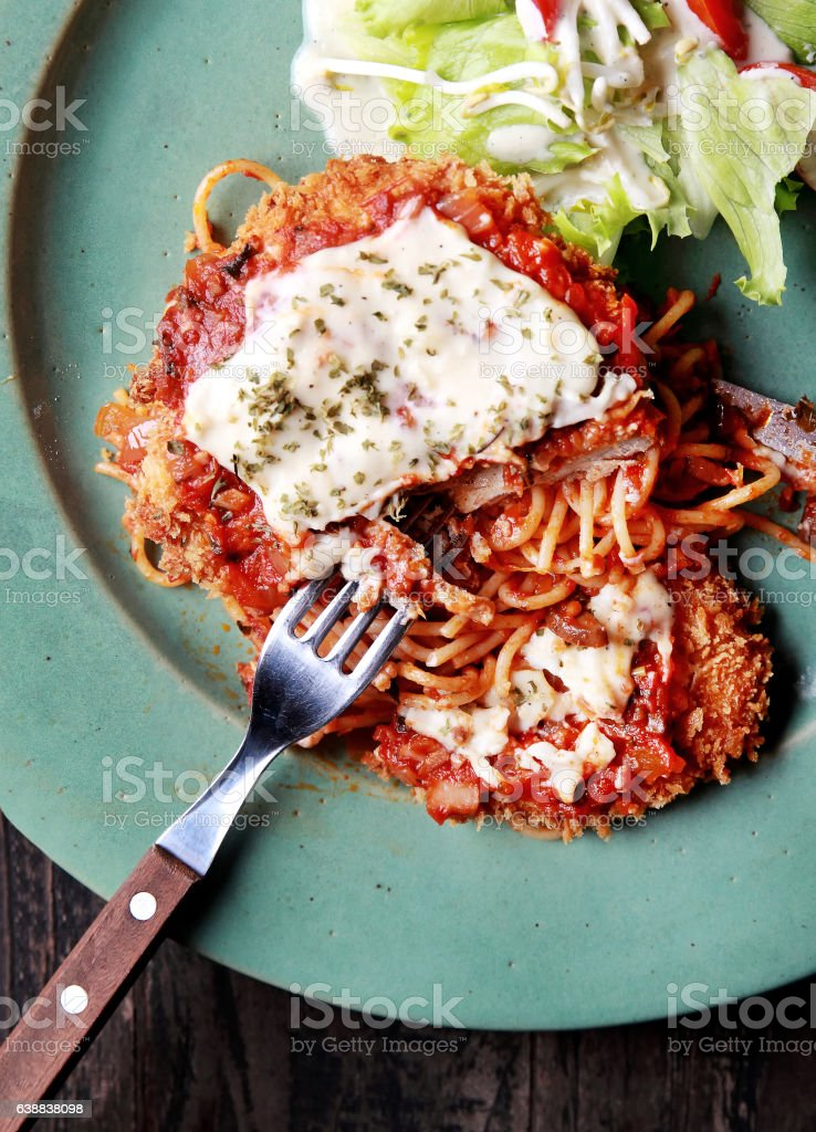 chicken parmigiana with spaghetti and salad stock photo
