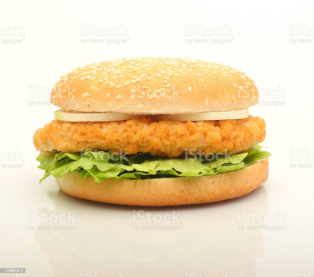 Chicken patty with lettuce and onion on a seeded bun stock photo