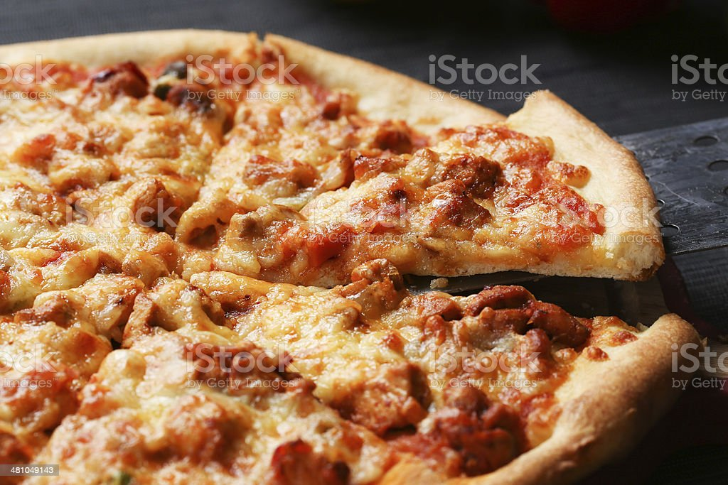 Chicken Pizza Lifted Slice stock photo