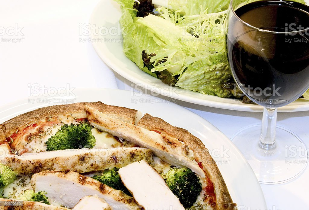 Chicken Pizza with salad and wine royalty-free stock photo