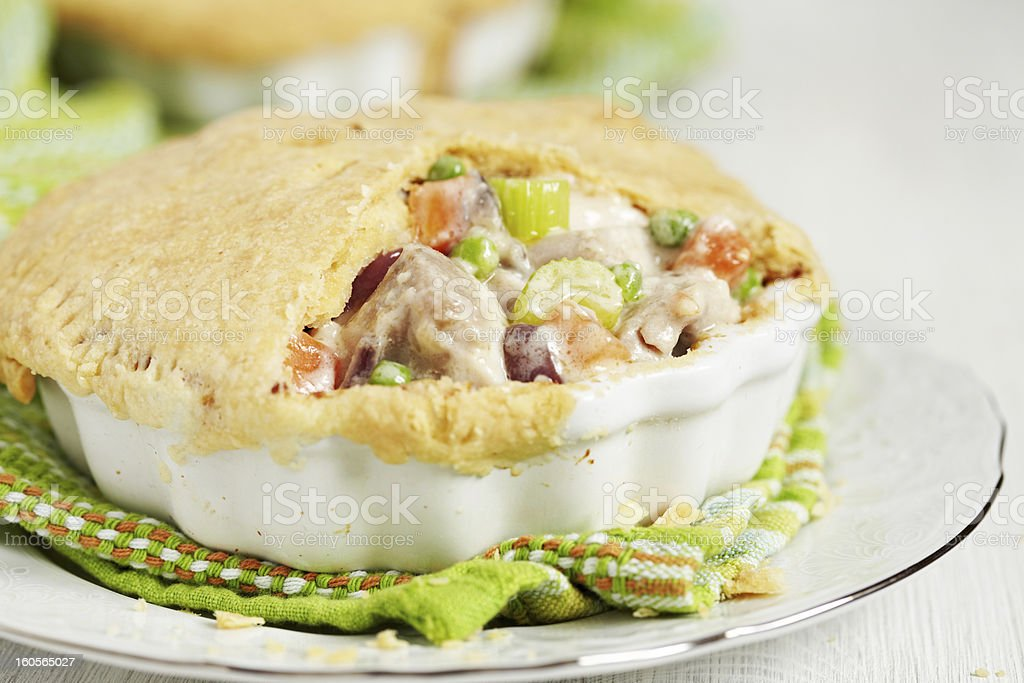 A chicken pot pie on top of a green kitchen towel stock photo