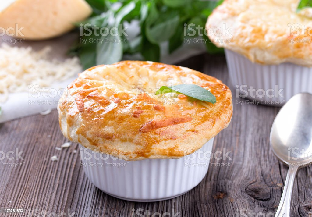 Chicken pot pie with cheese and basil stock photo