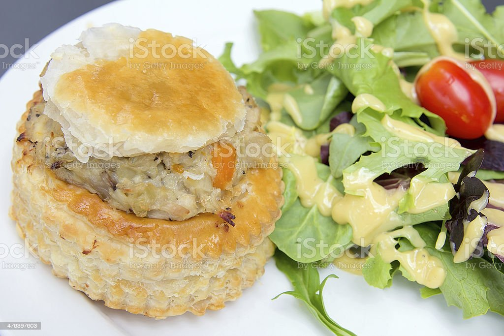 Chicken Pot Pie with Salad Closeup royalty-free stock photo