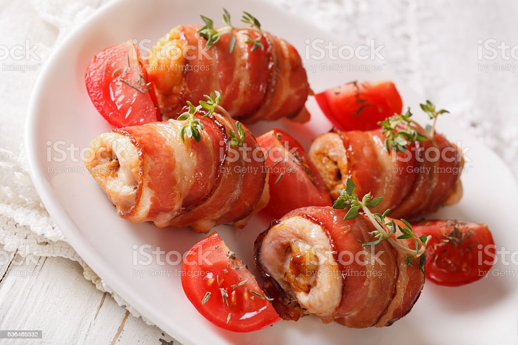 Chicken roll baked with bacon close-up. horizontal stock photo
