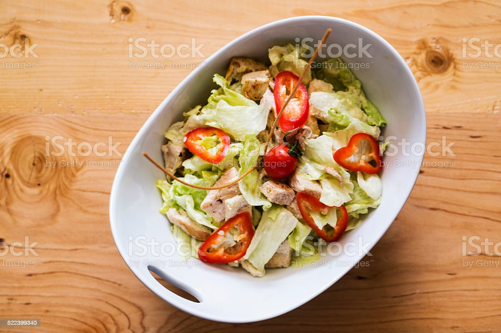Chicken salad ith colorful vegetables and herbs stock photo