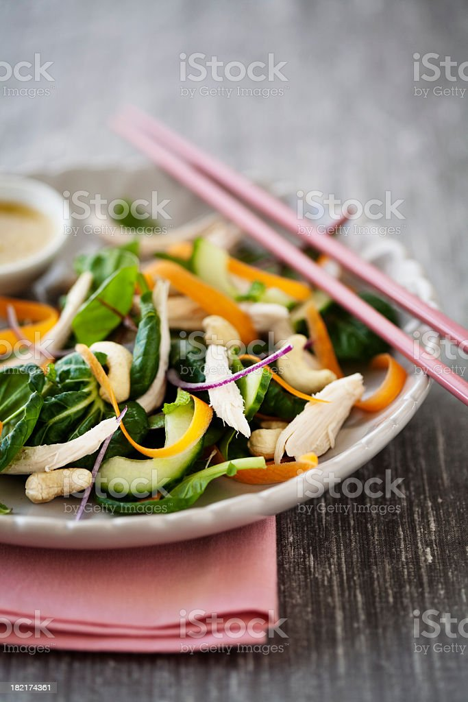 Chicken salad on a plate with chop sticks stock photo