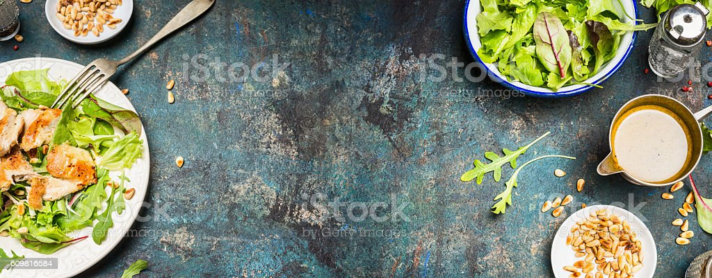 Chicken salad with green leaves,pine nuts and oil dressing stock photo