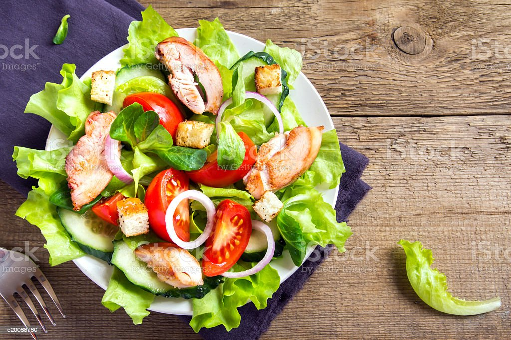 Chicken salad with vegetables stock photo