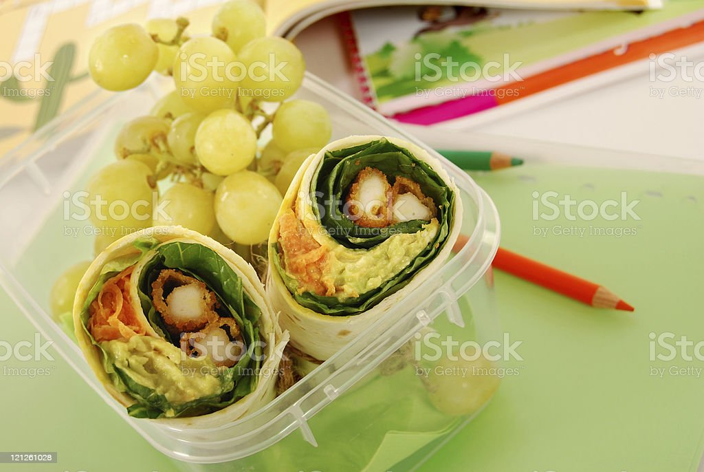 Chicken salad wrap and grapes packed lunch for school royalty-free stock photo