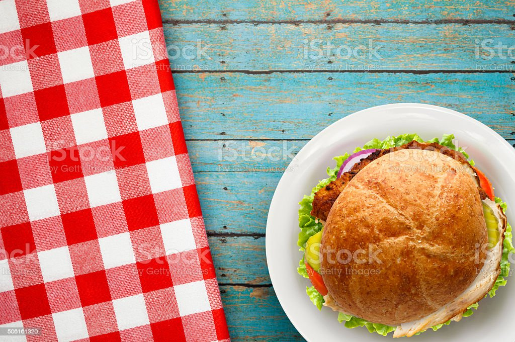 Chicken Sandwitch on Whole Wheat Red Checked Napkin stock photo