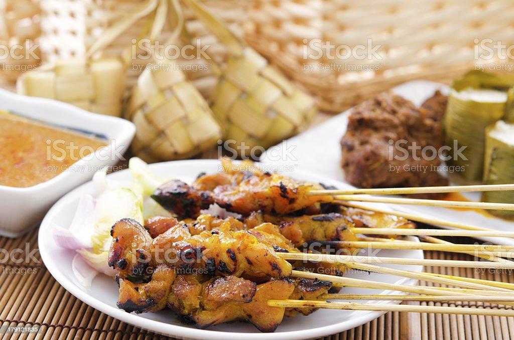 Chicken satay and ketupat stock photo