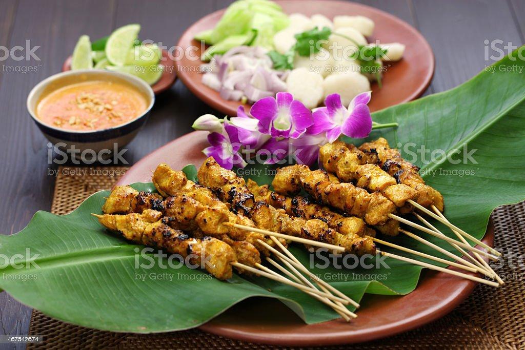 chicken satay with peanut sauce, indonesian skewer cuisine stock photo