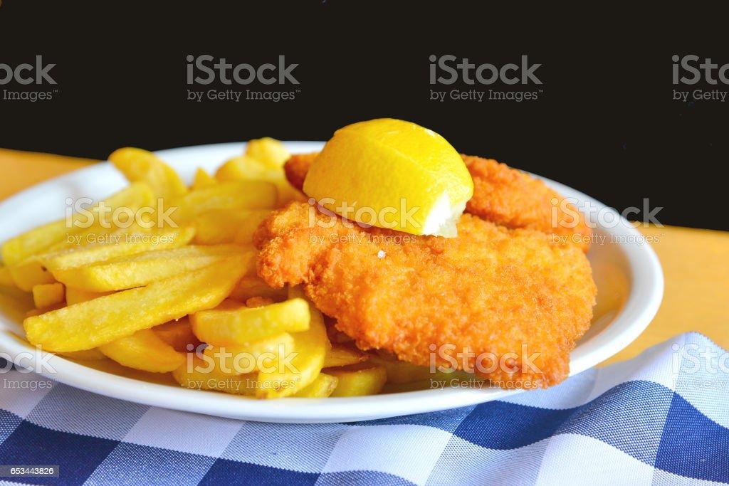 Chicken Schnitzel with fries stock photo