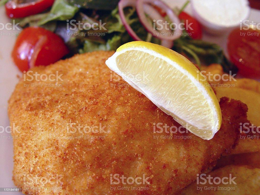 Chicken schnitzel with lemon stock photo