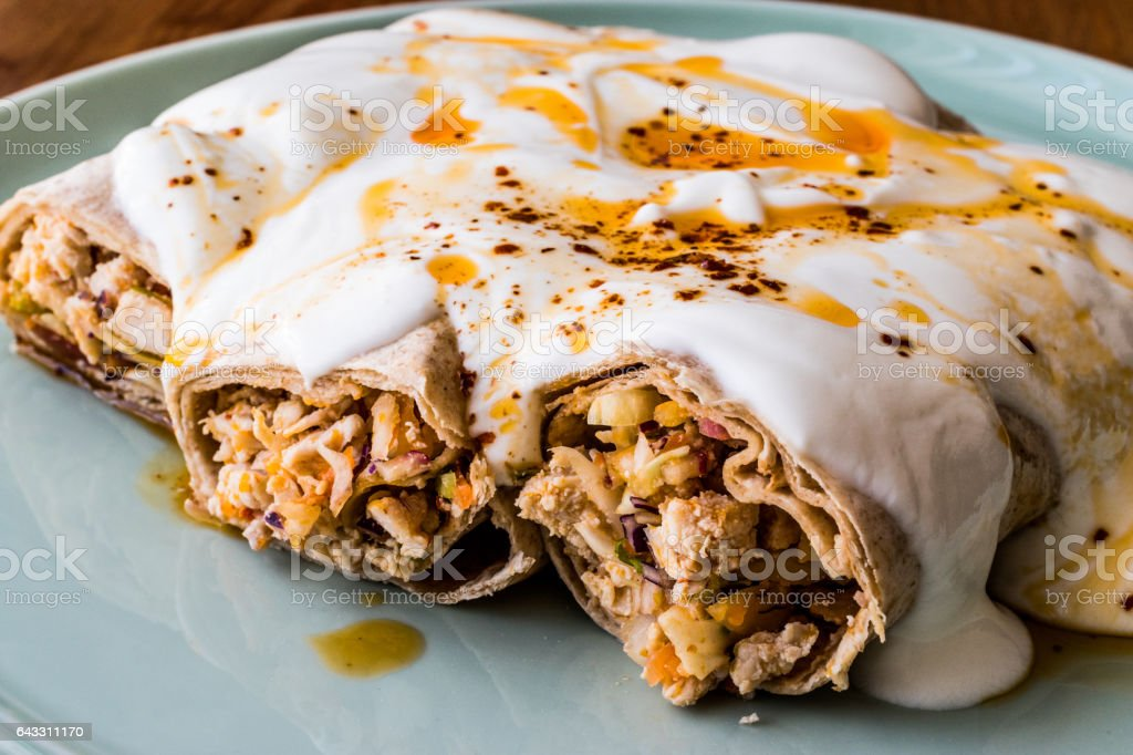 Chicken shawarma kebab with yogurt and fried butter sauce / Tantuni Special. stock photo