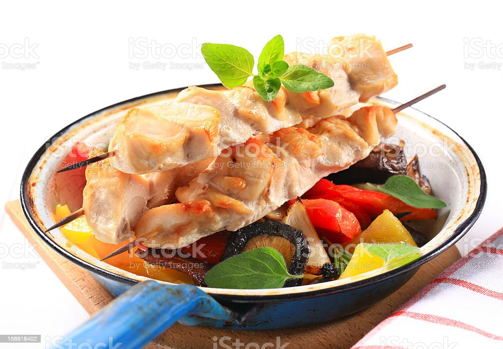 Chicken skewers and vegetables royalty-free stock photo