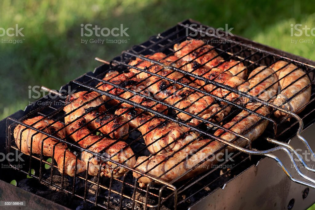 Chicken skewers on grill stock photo