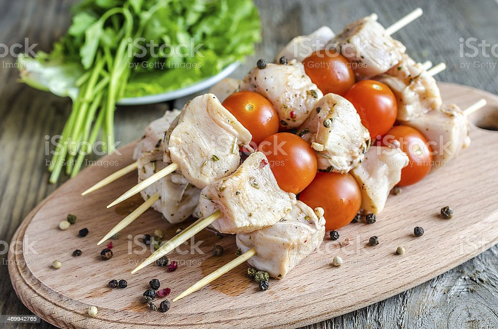 Chicken skewers with cherry tomatoes royalty-free stock photo