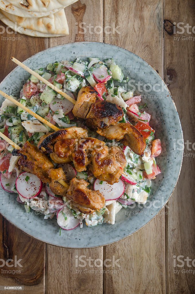Chicken skewers with fattoush stock photo