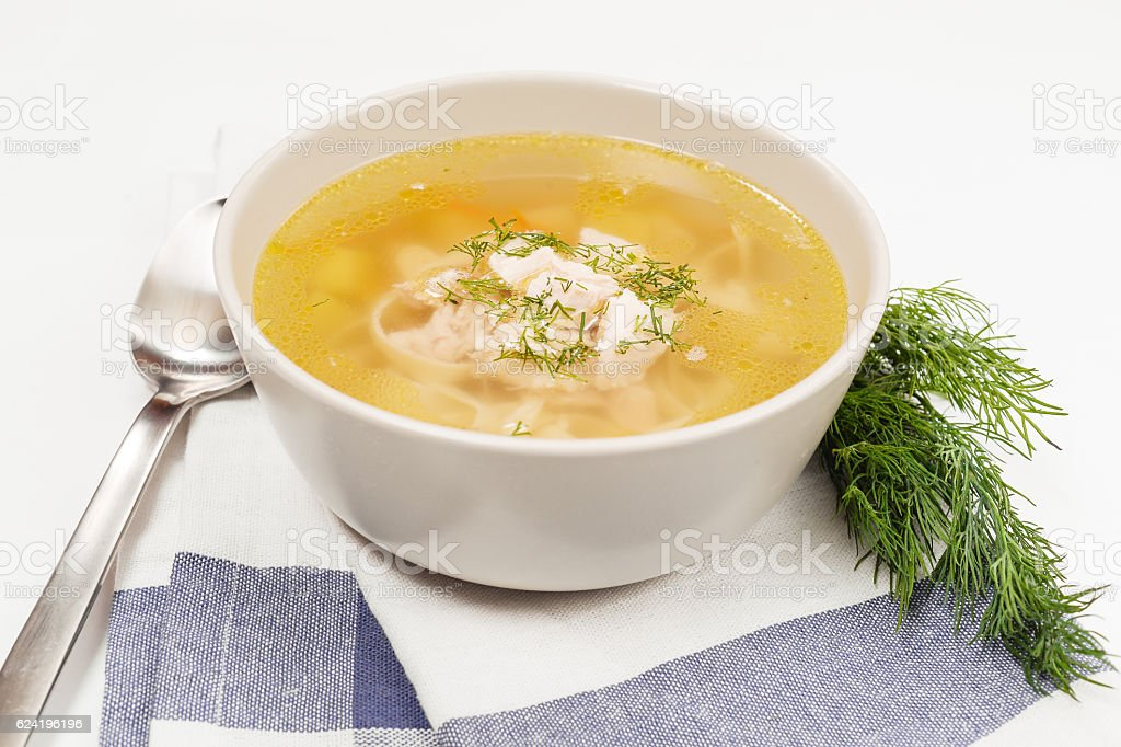 Chicken soup on white stock photo