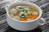 chicken soup with meatballs, carrot and potato sprinkled with pa