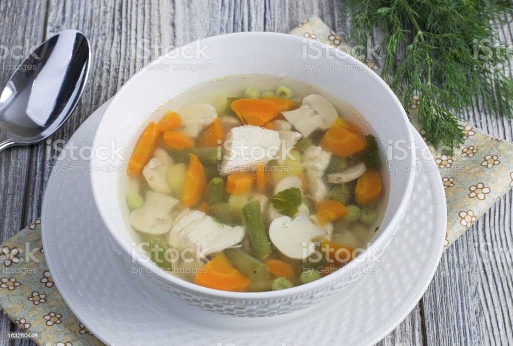 Chicken soup with vegetables and mushrooms royalty-free stock photo