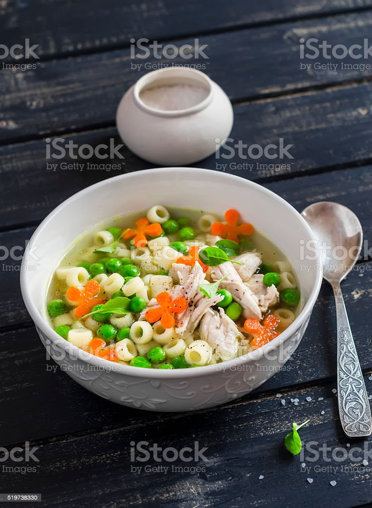 Chicken soup with vegetables and pasta stock photo