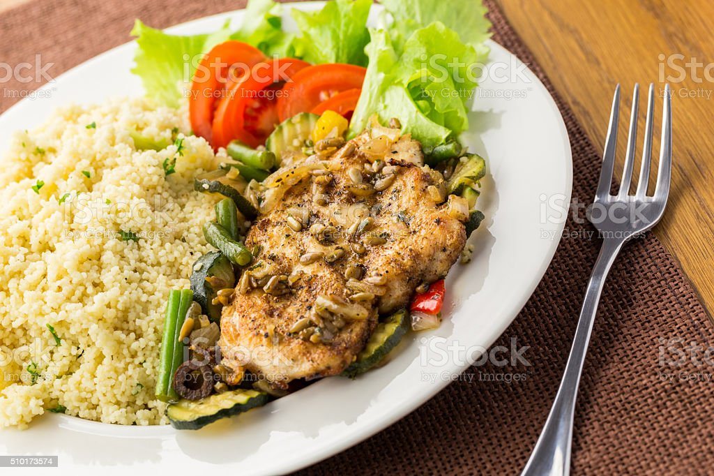 Chicken steak with couscous royalty-free stock photo