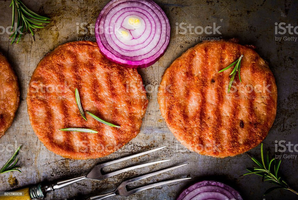 Chicken steak with red onions and rosemary on a tinware stock photo