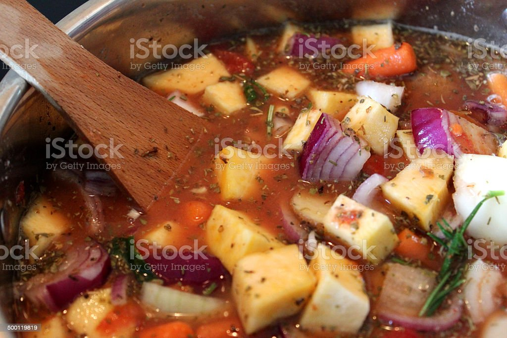Chicken stew / vegetable casserole cooking in saucepan / pan, vegetable soup stock photo